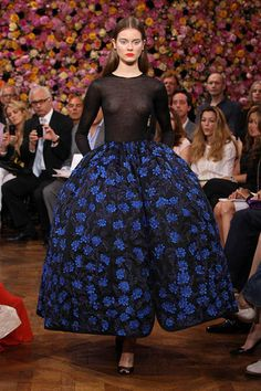 Dior Haute Couture Autumn-Winter 2012 – Look 48: blue or black knitted cashmere top with a black duchess satin skirt embroidered with electric blue flowers. Discover more on www.dior.com  #Dior #PFW