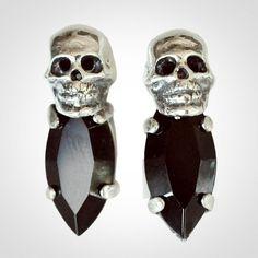 Tiny skull stud earrings by Iosselliani.