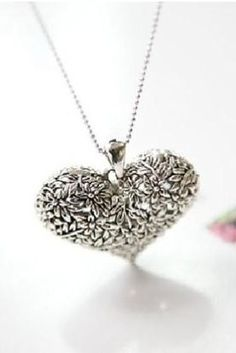 "This is a very cute design. Looking closely at the heart, you will see a textured, flower design. The heart is also hollow so it doesn't weight a lot when you wear it. Puffed, hollow heart is 1.75"" inches long and 1.50"" inches long. The chain is 19"" inches long. Ships out the Los Angeles area, from a smoke free home."