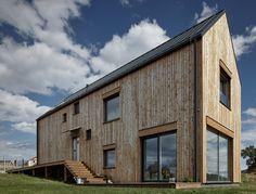 Mjölk Architekti references agriculture with barn-like house