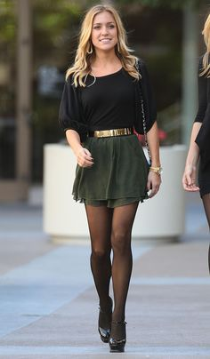 Black blouse. Gold belt. Army green skirt. Black hose. Gold watch. Black heels or ankle boots. Classy.