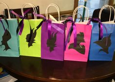 Super cheap and easy to make villains goodie bags: the bags and ribbons I got them in my local tree dollar, and the template I download from the website provided. I just cut the template and glued it to the bag and tie a ribbon on them just to make them a little more fancy.