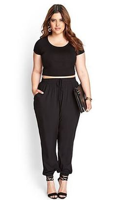 Surprisingly this works for inverted triangle body types and triangle body types- it's all about the pairing. Black crop top and joggers. Plus size, extended sizes. Forever 21.