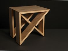 M Stool - J1: Each stool is made of three triangles. Two stools form a cube, eight can fit into a circle, can be stacked vertically to create a screen. Available in oak, walnut, maple.