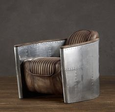 Aviation chair by Restoration Hardware (I deliver these and want the aviator set for my SteamPunk theamed office/library!) Ridiculously expensive furniture though.