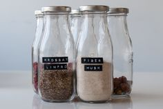 Old jars repurposed to hold bulk dry goods for a zero waste, plastic-free kitchen