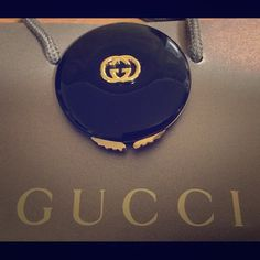 Vintage Gucci Compact! Coming soon! Vintage Gucci Compact - Authentic! gold emblem and handles in beautiful condition and clean throughout. I believe it is enamel. Mirror is aging, minor light scuffing. Gucci stamped on rim of mirror. Gucci Makeup