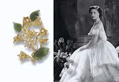 Princess Margaret's Donald JADE &  DIAMOND FLOWER BROOCH, textured Escallonia spray with brilliant-cut diamond stamen and three carved nephrite jade leaves, 18 carat gold,  1977