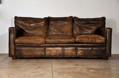 worn brown leather couch
