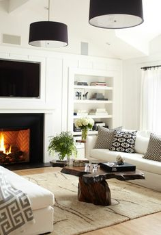 DIY decoration: Loving this modern black & white living room with rustic wood coffee table and drum pendant lighting !!
