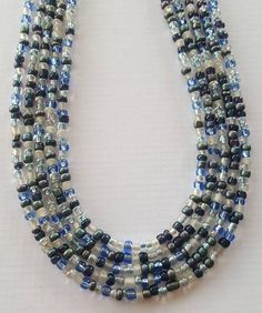 Check out this item in my Etsy shop https://www.etsy.com/listing/484544941/blue-multicolored-necklace-seed-bead