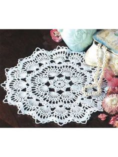 """Fans radiate from the center of this doily to create an elegant table accent. Size: 10"""" across."""
