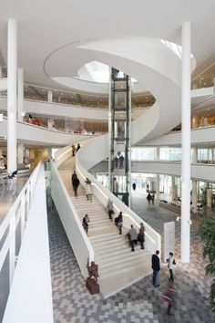 Spiral staircase that doesn't inhibit your view and is incorporated into the atrium/public area. designed by 3XN and the building is Stadshuis Nieuwegein