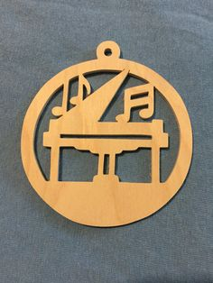 Scrollsawn handmade round wood piano with music notes Christmas tree ornament