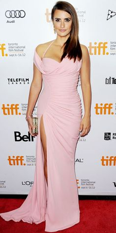 Penelope Cruz walked the Toronto Film Festival red carpet for the Twice Born premiere in a draped Atelier Versace gown, gold jewelry and a box clutch.