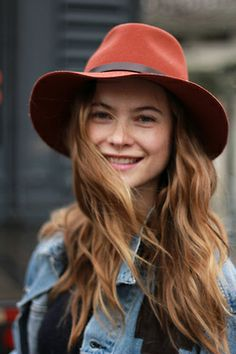 Hat and smile.