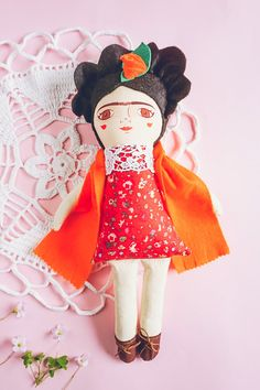 Frida: Handmade doll / Cloth doll / stuffed doll  Frida and her colorful image give life to this cloth doll with handpainted details, tender brushstrokes that seek to capture her essence and sensibility through flowers, colors, thick eyebrows and red lips. Also bringing to life the historically powerful image of Frida, inspired by her artwork and her unique and intense life.  Her face is printed in cotton fabric with water-based inks * This doll doesnt have his face painted by hand, it is…