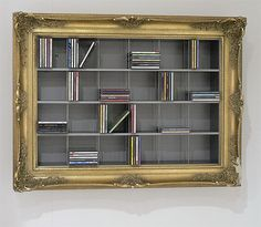 Another idea would be to frame your DVD shelf as if it were an art work: This is from via #homes #storage