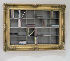 DIY Frame DVD shelf as if it were an art work