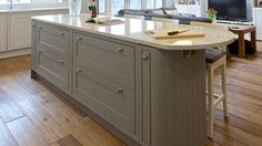 Fitzgerald Kitchens | View a High Gloss Ivory & Walnut Kitchen. Visit our Dublin Showrooms in Dun Laoghaire & Dundrum.
