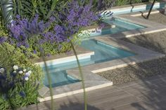 Our Bespoke Sawn Travertine Copings featured in Esra Parr's beautiful gold medal-winning 'Spirit of the Aegean' garden at RHS Hampton Court Flower Show 2015.