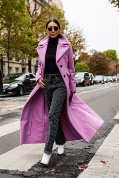 This dramatic lilac coat is everything. Get this and more outfit ideas and inspiration from Paris fashion week. #parisfashionweek #fashionweek #fashion #outfitideas #fallfashion #fall