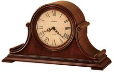Hampton Mantel Clock. This aged-styled mantel clock will make it feel like you have an antique in your house. Highlighted with bookmatched molding that frames the dial and offers scrolls on the sides.  Quartz, battery-operated, dual-chime Kieninger movement. Volume control, automatic nighttime volume reduction option, and automatic nighttime chime shut-off option. Requires two C sized batteries.