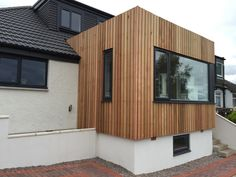 vertical western red cedar and white render on Milngavie extension design by Milngavie architects Extension Designs, Western Red Cedar, Restaurant Design, Glasgow, Architects, Facade, Shed, Woodworking, Outdoor Structures