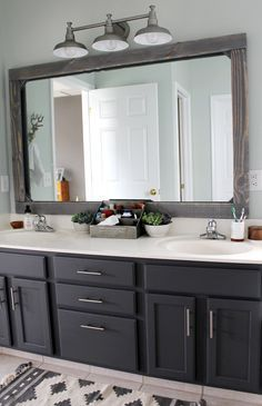Just a few weeks ago we finished our master bathroom makeover on a tiny  budget (about $300!) and I received several requests for a tutorial on how  to make the mirror. Full disclosure--covering our mirror wasn't my original  idea! I spotted it at Cherished Bliss several months ago and I was  de