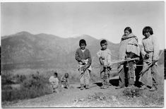 HISTORY | Taos Pueblo boys hunting with bows. Sharpshooters from an early age, boys played games that taught marksmanship and honed reflex.