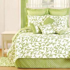 Refresh your master suite or guest room with this charming cotton quilt, showcasing a scrolling vine motif.