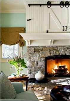I love the barn doors over the fireplace. Driven by Decor