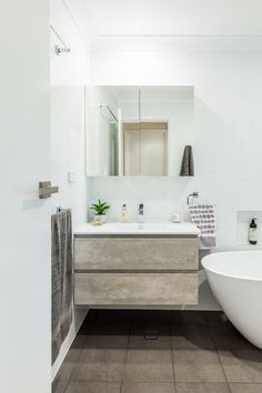 Concrete timber look vanity. Small Bathroom Renovation in Alstonville NSW 2477 By Northern Rivers Bathroom Renovations (NRBR), Ballinas specialist bathroom renovator. Bathroom Images, Small Bathroom, Bathroom Renovations, Double Vanity, Concrete, Bathtub, Rivers, House, Design