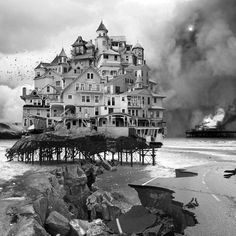 Jim Kazanjian started the series in 2006. His first image featured a dense cluster of buildings balanced above a crumbling pier (above), while others completed since then include a crumbling house being struck by lightning (below) and a castle-like building atop a waterfall.