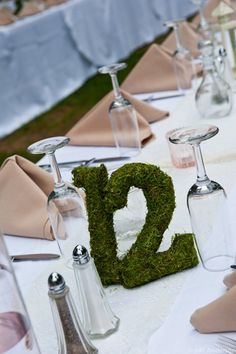 Rustic Romantic Themed Wedding/ Moss Covered Wedding Reception Table Numbers. $15.00, via Etsy.