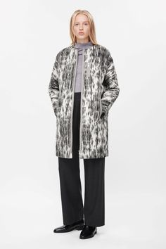 This zip-up coat is made from a softly structured cotton-wool blend with modern zip details. A long straight shape, it has a clean collarless neckline, three front pockets and is fully lined.