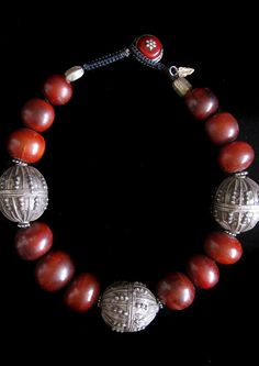 A thrilling find - old, dark brown amber from Mauritania. Ive paired it with antique silver Yemeni beads, a simple and dramatic statement that