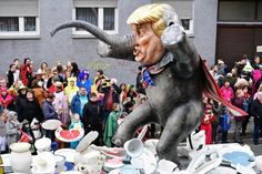 A float featuring a depiction of Donald Trump, drives in the annual Rose Monday parade, in Germany. (Thomas Lohnes / Getty)