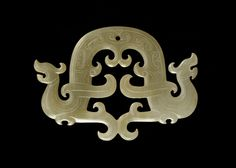 Pendant (pei) in the form of a dragon 5th-4th century B.C.E.   Eastern Zhou dynasty  Jade H: 4.5 W: 6.5 D: 0.5 cm China