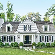Love love a gambrel roof.In architect Stan Dixon's skilled hands, a new life takes shape for this Cape Cod-style cottage in Atlanta's Haynes Manor neighborhood. House Roof, Facade House, Dutch Colonial Homes, Gambrel Roof, Home Exterior Makeover, Villa, Dream House Exterior, Construction, Cottage Style