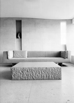 Pin a large stone coffee table, in its unadulterated, natural hue blends harmoniously with the rest of the furniture in this room. Minimalist Furniture, Minimalist Interior, Minimalist Home, Modern Furniture, Furniture Design, Minimalist Bedroom, Modern Sofa, Modern Wall, Luxury Furniture