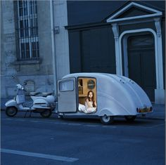 hippy's dream? airstream trailer towed by vespa