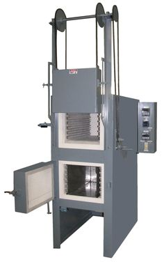 Lucifer Furnaces' most popular model: dual saving, space-saver, complete heat treat unit with small footprint.  Series 8000.  Top hardening chamber above tempering oven.  Custom made to meet your application.
