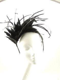 Black feather spray headpiece set on a hairband.