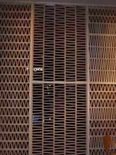 Tradition revisited by Patricia Urquiola for Tierras. Company called www.mutina.it Wall made of individual terracotta tiles leaning against each other like a pack of cards - ancient method allows ventilation and gives screening. At I Salone Milano 2014 photo by the interiorista