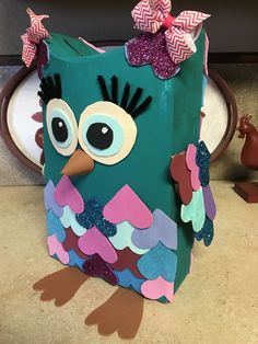 """Owl Valentine's Day box made from a cereal box painted with acrylic paint and foam paper. The heart """"feathers"""" were also carried from top to bottom on the back. Scrapbook paper would be great for the feathers! Valentine Day Boxes, Valentines For Kids, Valentine Day Crafts, Valentine Party, Valentine Ideas, Cereal Box Craft For Kids, Holidays With Kids, Happy Holidays, Craft Activities"""