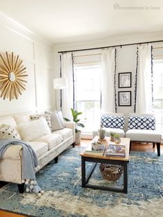 LOVE this! Spring Decor in Living room with DIY Sunburst mirror and blue accents
