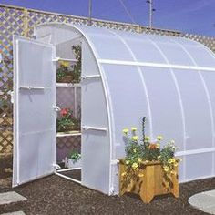 How To Build A Diy Raised Brick Planter Greenhouse With A Do It Yourself Pvc Pipe Irrigation
