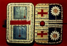 HIV pill art. Image description: a small purse has been lined with medication stiched into rows and in the shapes of daisies. It reveals a number of red crosses, like a first aid kit.