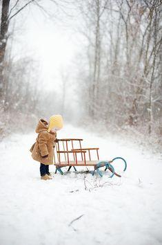 child, sled & snow